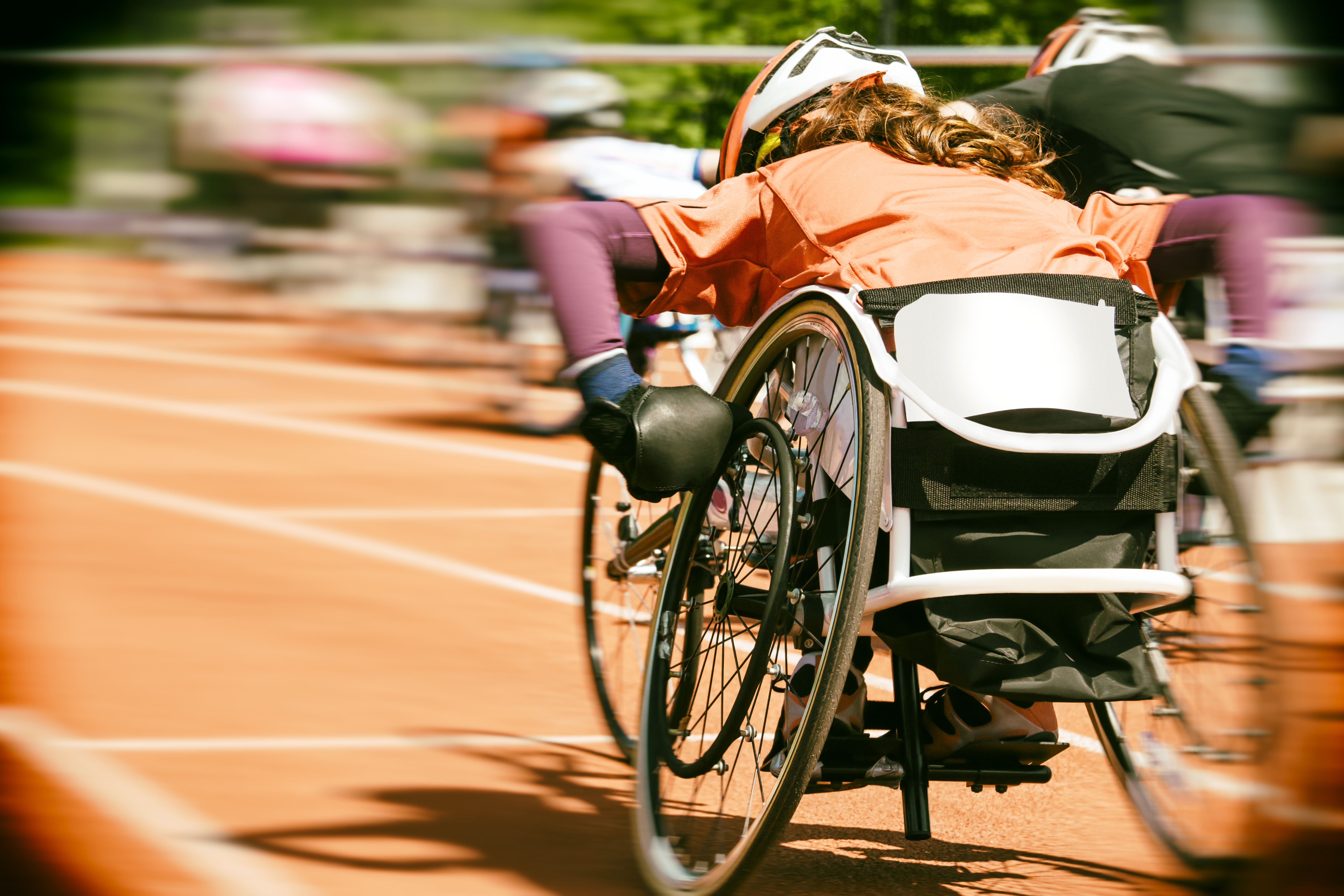 Person in wheelchair racing in an event