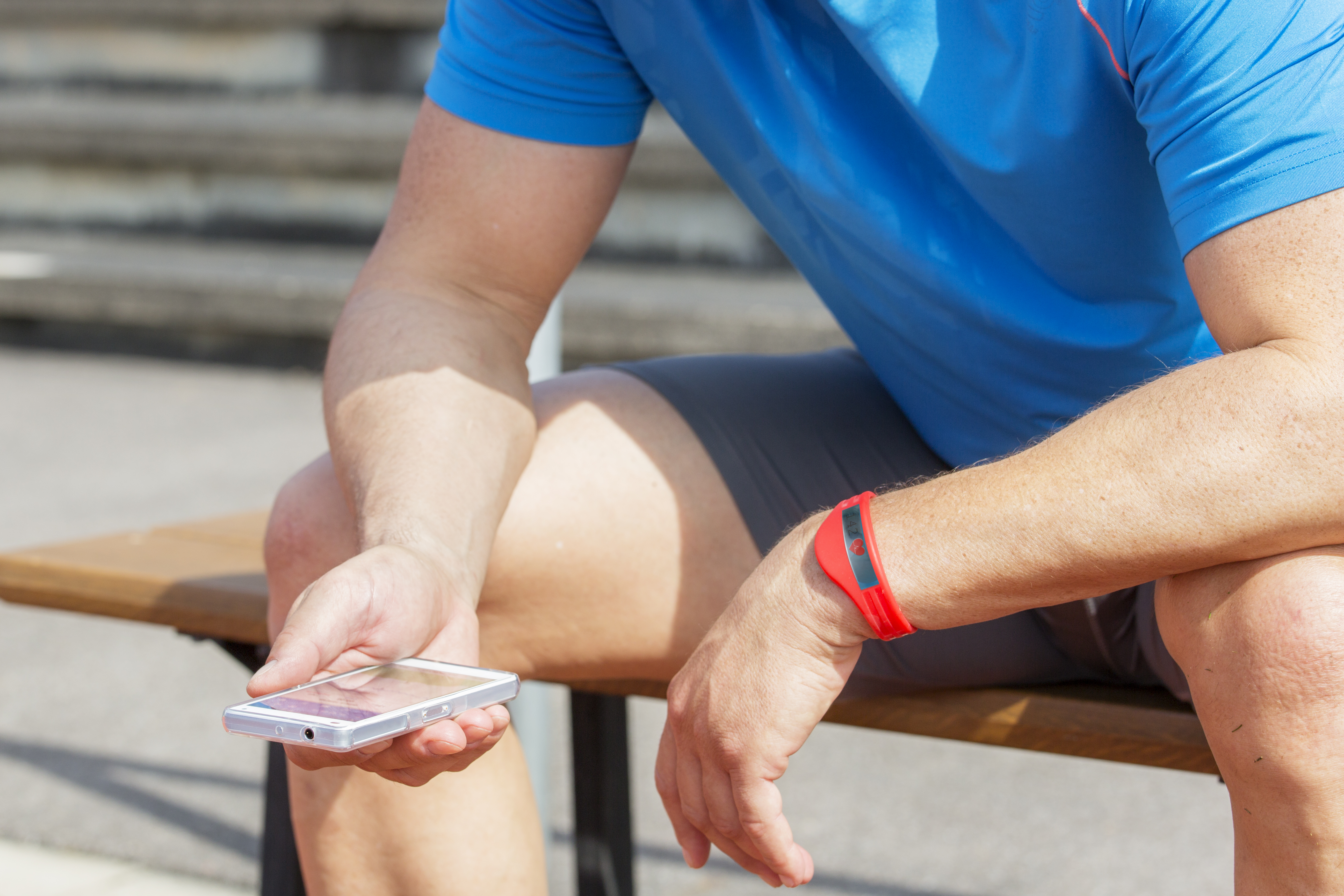 Athlete sitting down checking their phone
