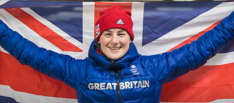 Olympic skeleton medallist, Laura Deas holding up a British flag